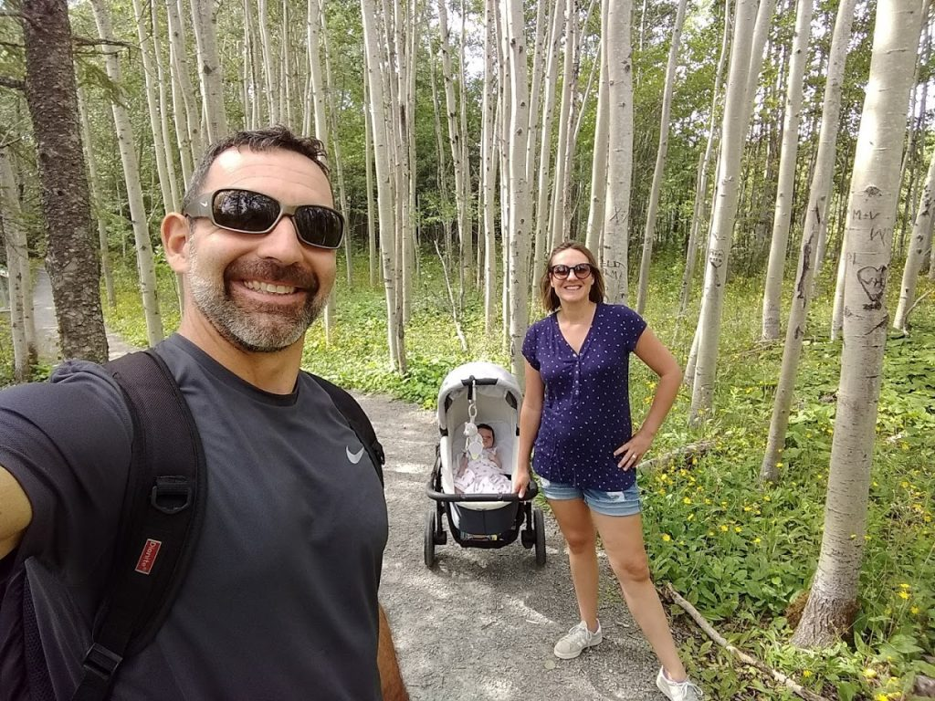 Family hiking in forest.