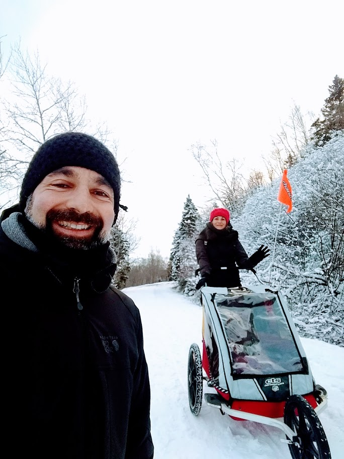 Family walking in nature after a snow storm in Gaspésie.